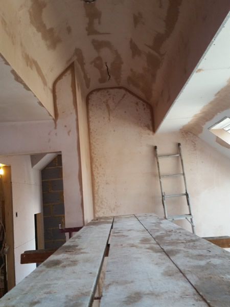 Curved detail ceiling in a loft conversion in harrow