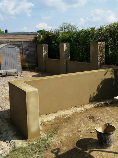 Smooth finished block wall in garden in st albans